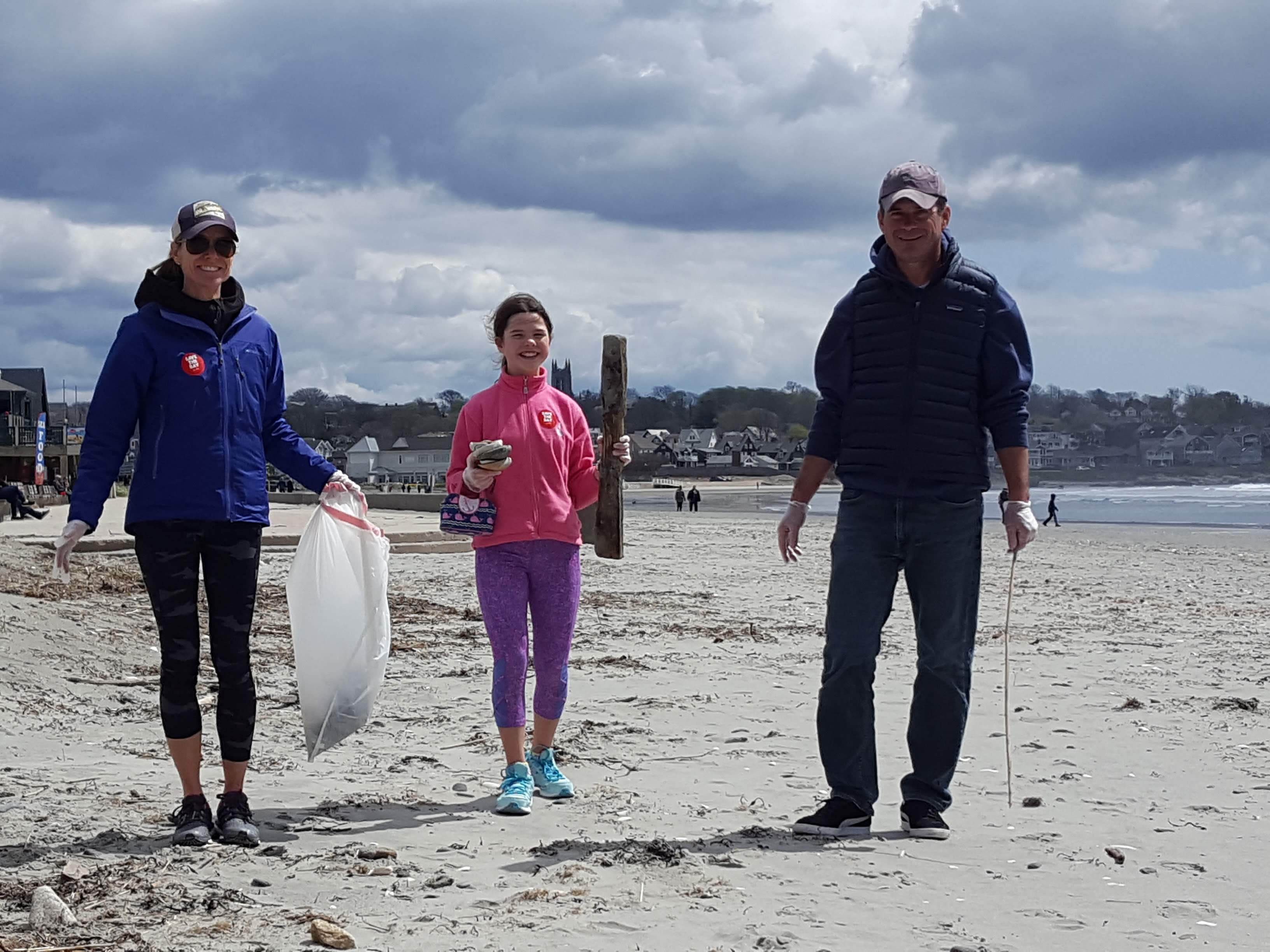Volunteers picking up trash at Easton's Beach