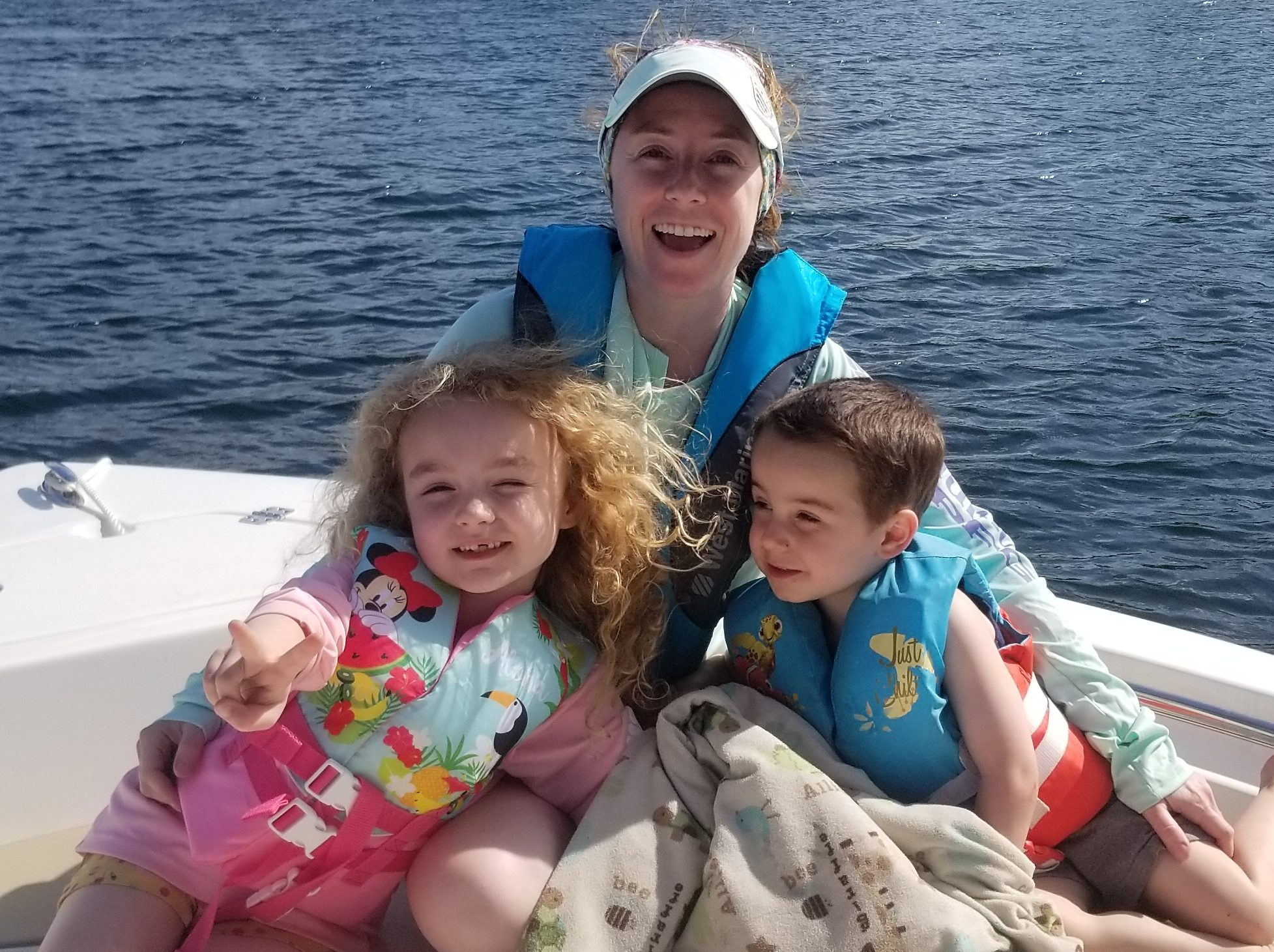 Woman with her two kids on a boat