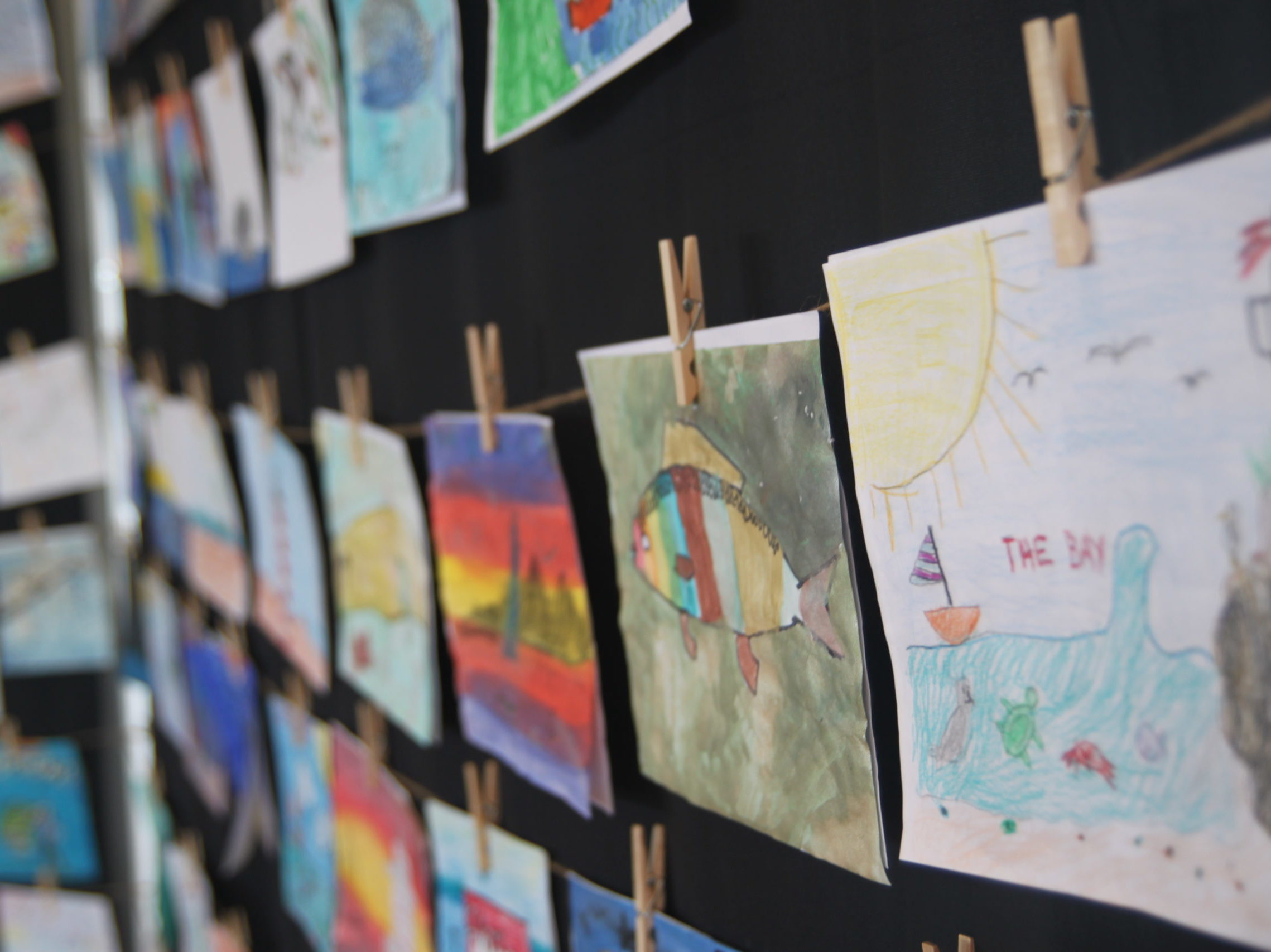 Entries of the 2019 Old School Art Contest on display at Save The Bays 2019 Earth Day Birthday Party