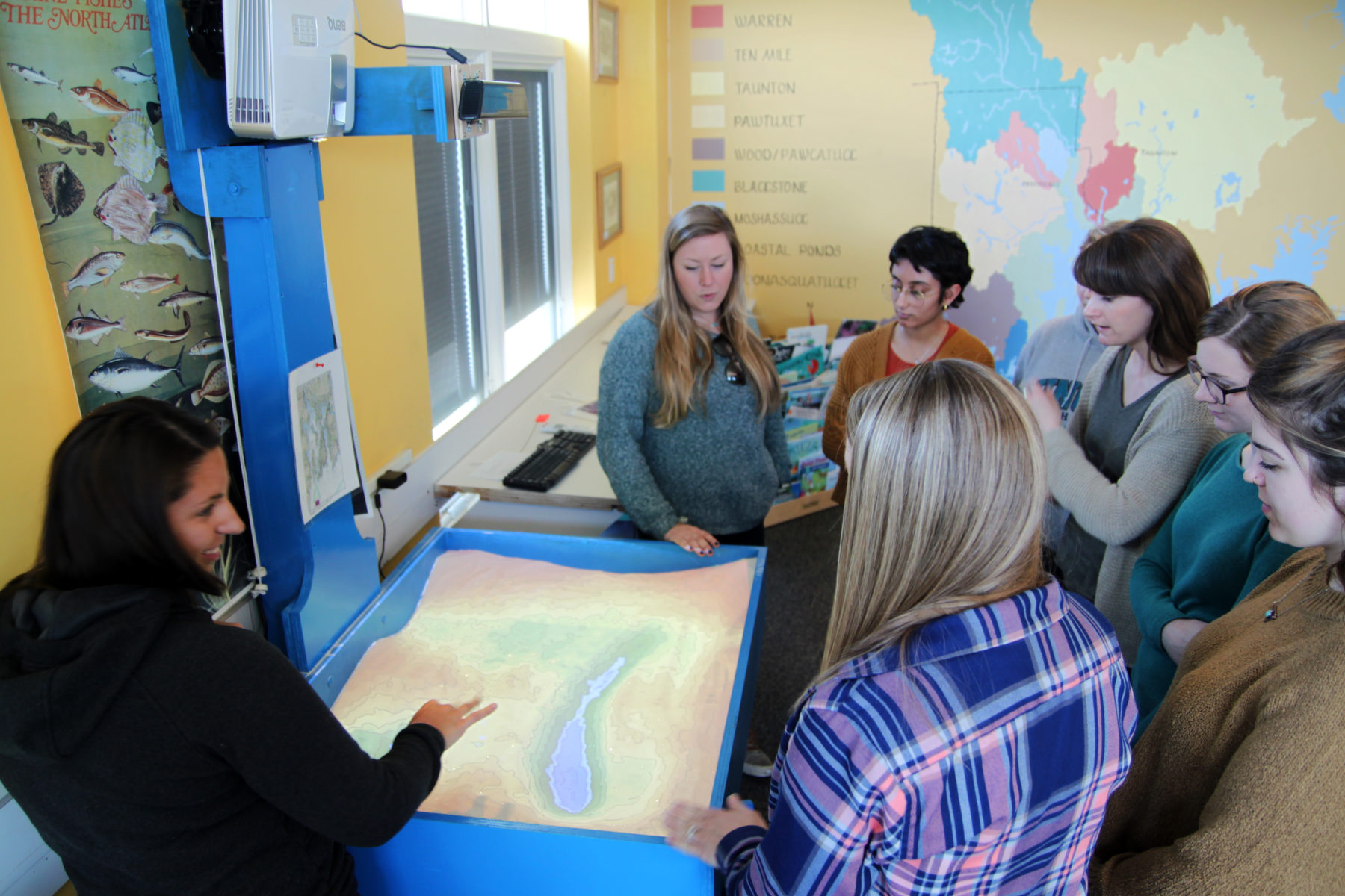 Save The Bay educators are trained to use the augmented reality sandbox.