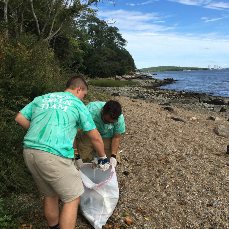 Roger Williams University students clean under the Mt. Hope Bridge