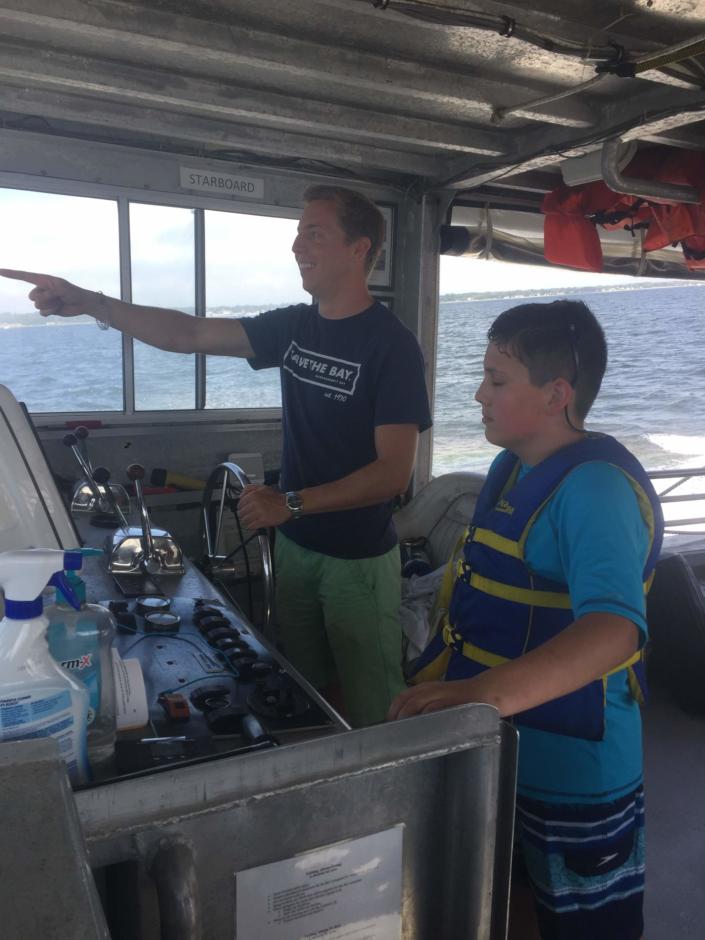 Captain Chris Dodge talks with a BayCamper aboard the Aletta Morris.