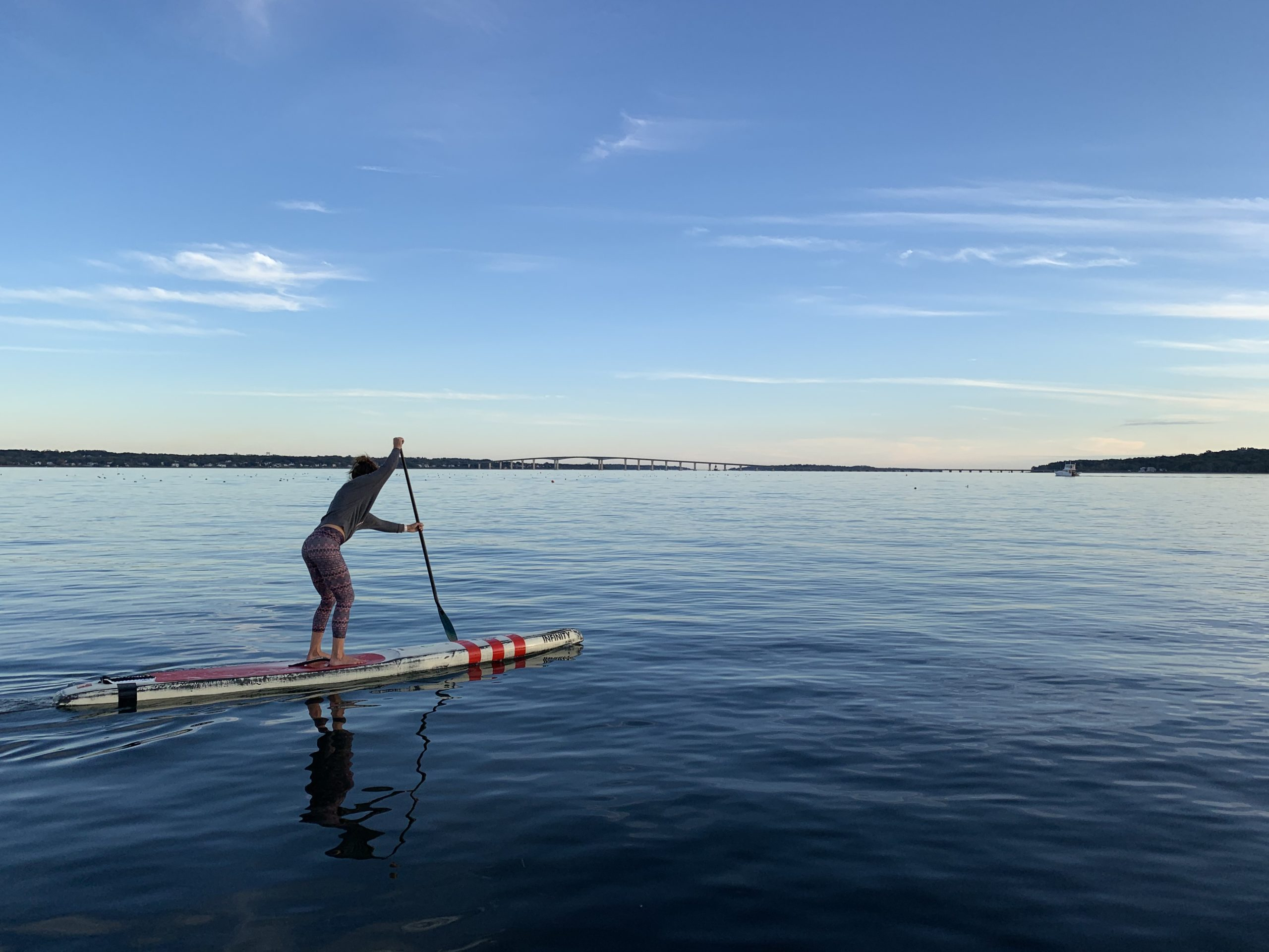 Woman on a stand-up paddleboard off Rome Point