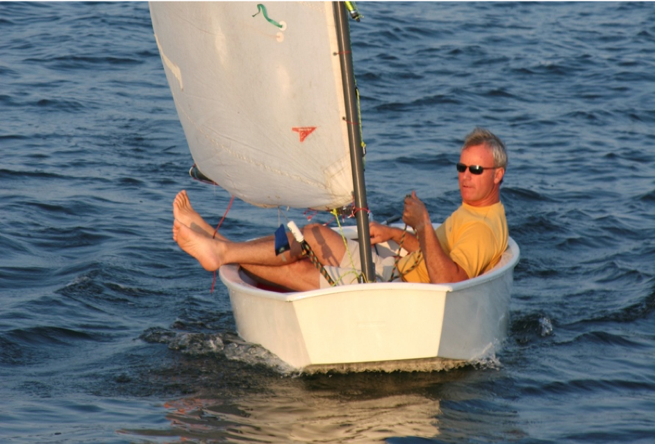 Michael Brown, shown here in a boat on local Rhode Island waters, was posthumously awarded the 2016 Environmental Achievement Award.